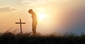 42258-womanstandingbycross-cross-silhouette-nature-ThinkstockPhotos-623611068_1200w_tn